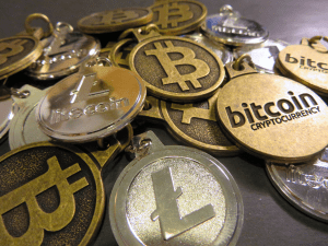 A bunch of of coins with the Bitcoin logo on them