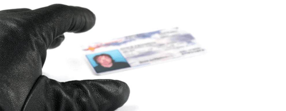 A gloved hand reaching for our credit card information