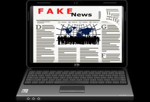 A laptop displaying fake news
