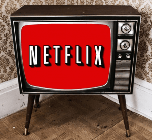 An old television showing Netflix on the screen