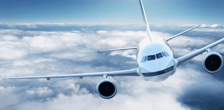 An airplane flying high among the clouds